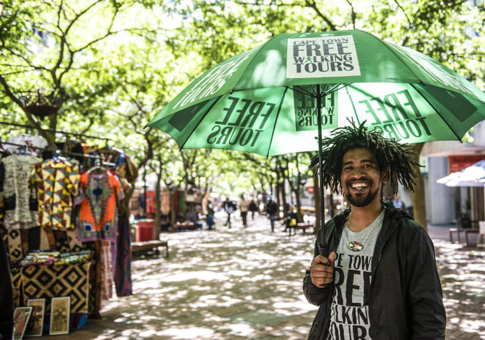 October 29 2019 - Slice of Life - Prins standing in St Georges Mall in the Cape Town CBD waiting to offer free tours of the city. photo by David Harrison